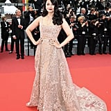 Aishwarya Rai attended the same premiere in a lacy champagne number.