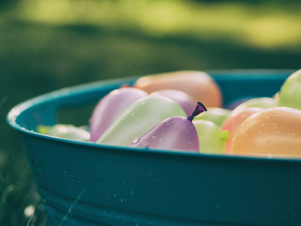 Participate in a water balloon fight.