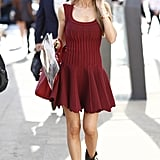 How to get away with a sexier red-hued dress like this for day? Just add edgy ankle boots to offset the va-va-voom. Source: Greg Kessler