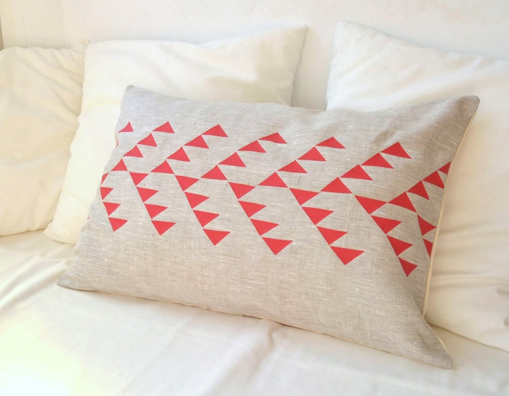 Repeating triangles create an arrow pattern on this Natural Linen Pillow ($34).