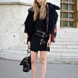 If you have an edgier black dress, channel the new punk '70s trend by pairing it with plaid, a fur coat, vintage sunglasses, or all three.