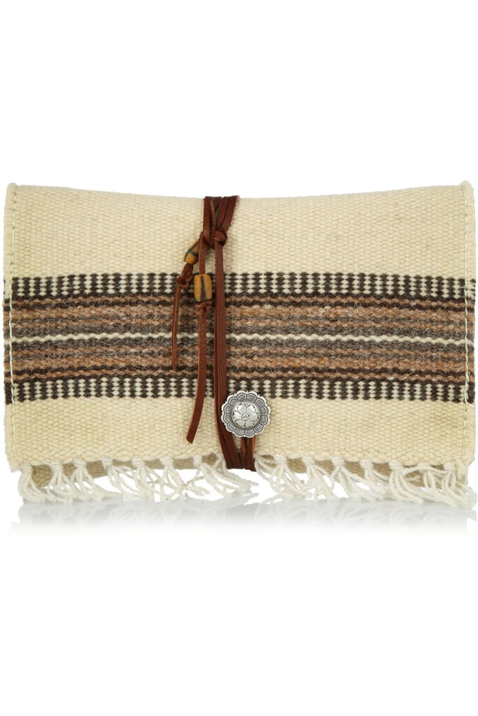Try this sophisticated take on a totally bohemian-feeling add-on.  TOTeM Salvaged Leather-Trimmed Cotton Clutch ($275)