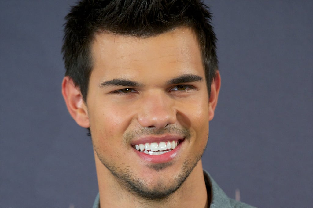 Taylor Lautner smiled in Madrid.