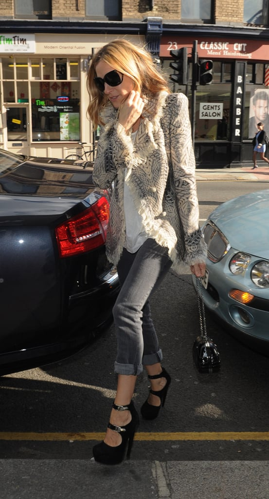 Sarah Jessica Parker visited Alexander McQueen's offices in London donning gray jeans, double-strap platforms, and an exquisite Alexander McQueen jacket.