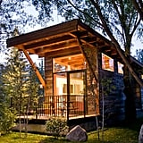 "Aptly named ""The Wedge,"" this chic cabin features large windows to create the appearance of open space. Wheelhaus also builds all its tiny homes on wheels, allowing buyers the option of mobility with their small dwellings. Because of this fun feature, The Wedge's large windows can take in views of relaxing beaches and lush forests, not limited to one or the other."