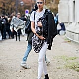 What's special about Stella Maxwell's boots is the front zipper, which slides all the way down. The model chose to wear her shoe with white denim during Paris Fashion Week.