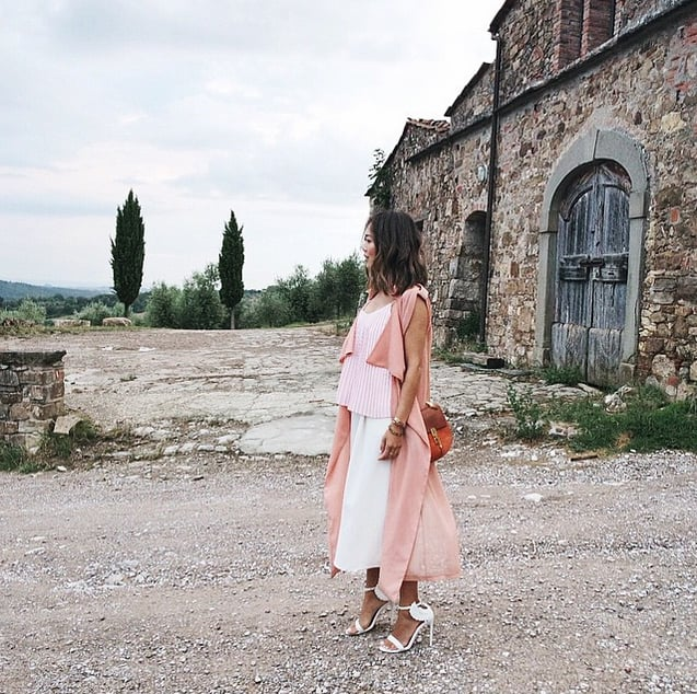 Aimee Song provides this photo with all the colour it needs. Wearing pink pastel separates, she looks romantic in a decidedly abandoned yet totally beautiful setting.
