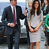 Prince William held an umbrella over Kate Middleton's head while heading into a London theater in April.