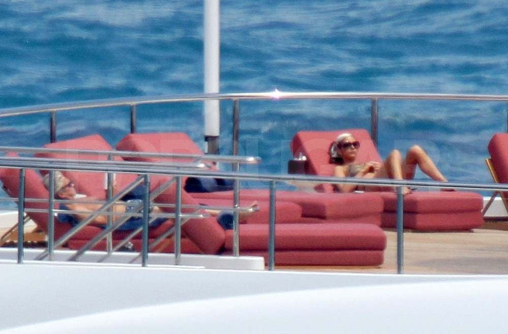 Catherine Zeta-Jones wears a bikini on a yacht in Italy with shirtless Michael Douglas.
