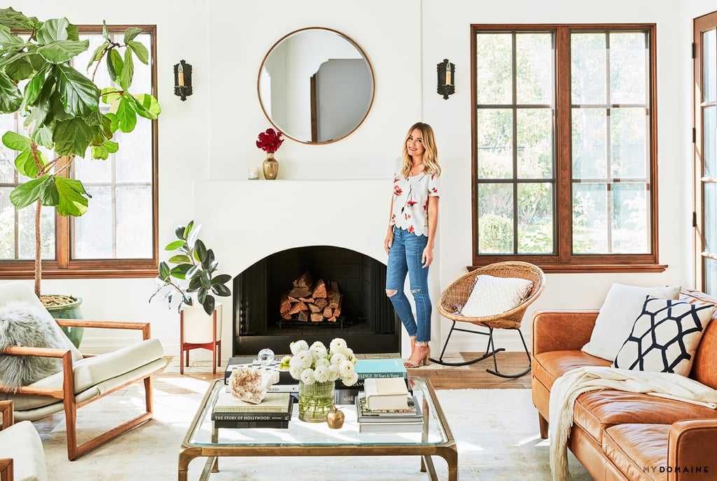The calmness that pervades the home is particularly abundant in the open, light-filled living room. Lauren furnished it with a mix of mid-century modern pieces and a pair of vintage chairs she found on Chairish.