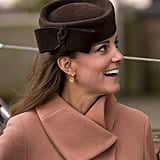 Kate's deep brown Betty Boop hat from Lock & Co added a rich contrast to her coat at the Cheltenham Festival IN 2013.