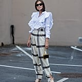 With Plaid High-Waisted Trousers and Classic Shoes