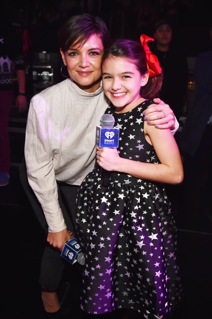Katie Holmes brought her 11-year-old daughter, Suri Cruise, to Z100's Jingle Ball concert in NYC on Friday night. The mother-daughter duo smiled and held hands as they addressed the crowd on stage with radio personality Elvis Duran, and they posed for a cute photo backstage before checking out performances from Taylor Swift, Demi Lovato, Sam Smith, and Liam Payne. Katie kept things casual in a sweater and jeans, while Suri looked especially festive in a star-print dress and bright red bow. One celebrity who wasn't in attendance at the show was Katie's boyfriend, Jamie Foxx; the two have been in a low-profile relationship since 2013, and while they have yet to make an official appearance as a couple, they were spotted walking hand in hand on the beach in September. Katie also stepped out to support her man at the opening of his NYC eyewear store just this week.      Related:                                                                                                           Katie Holmes Shares an Incredibly Sweet Bond With Her Daughter, Suri Cruise