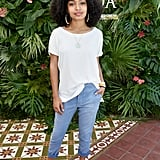 Yara Shahidi wearing a T-shirt, jeans, and mules at the POPSUGAR x CFDA brunch.