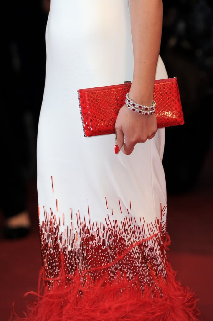 Cheryl Cole matched her accessories and makeup to her red train.