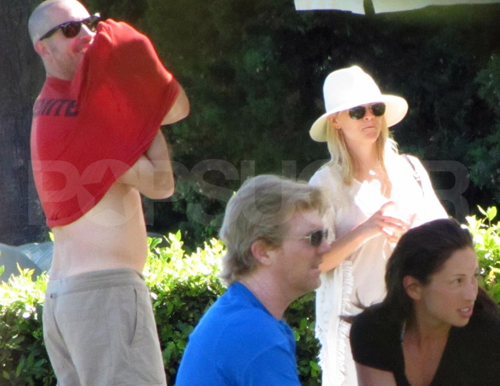 Reese Witherspoon and Jim Toth at the pool at their hotel.