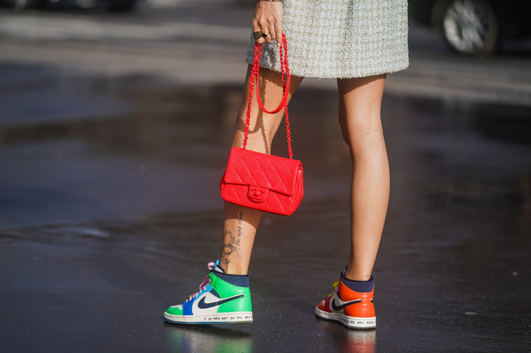 PARIS, FRANCE - MARCH 03: A guest wears a red quilted Chanel bag, Nike colored sneakers shoes, outside Chanel, during Paris Fashion Week - Womenswear Fall/Winter 2020/2021 on March 03, 2020 in Paris, France. (Photo by Edward Berthelot/Getty Images)