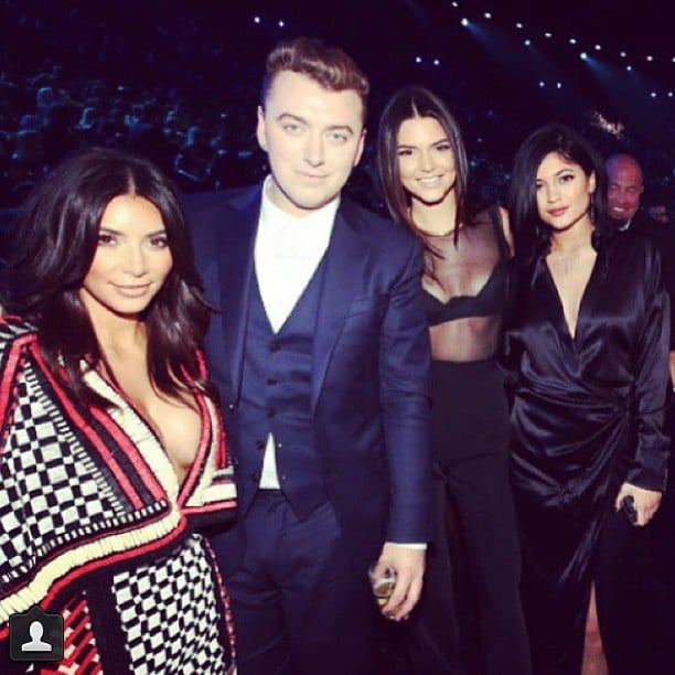 """Love these girls,"" Sam Smith wrote about his photo with sisters Kim Kardashian and Kendall and Kylie Jenner."
