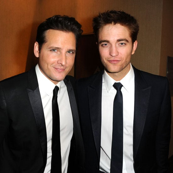 Robert Pattinson only had a few words to say as a presenter during the Golden Globes, but after his duties on stage he brought his sexy stare to hit up the after parties last night. He met up with his Twilight co-star Peter Facinelli at the HBO bash, while elsewhere on the Weinstein red carpet Rachel Zoe was excited about the prospect of catching a glimpse of him. Olivia Wilde had kind words to say about teaming up with him to hand out the best foreign picture globe as well. It was a long evening for Robert, who spent most of the weekend working hard on Water For Elephants reshoots.
