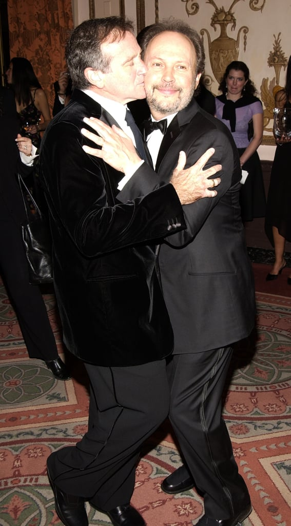 Robin gave pal Billy Crystal a smooch at NYC's American Museum of the Moving Image where Billy was awarded in February 2003.