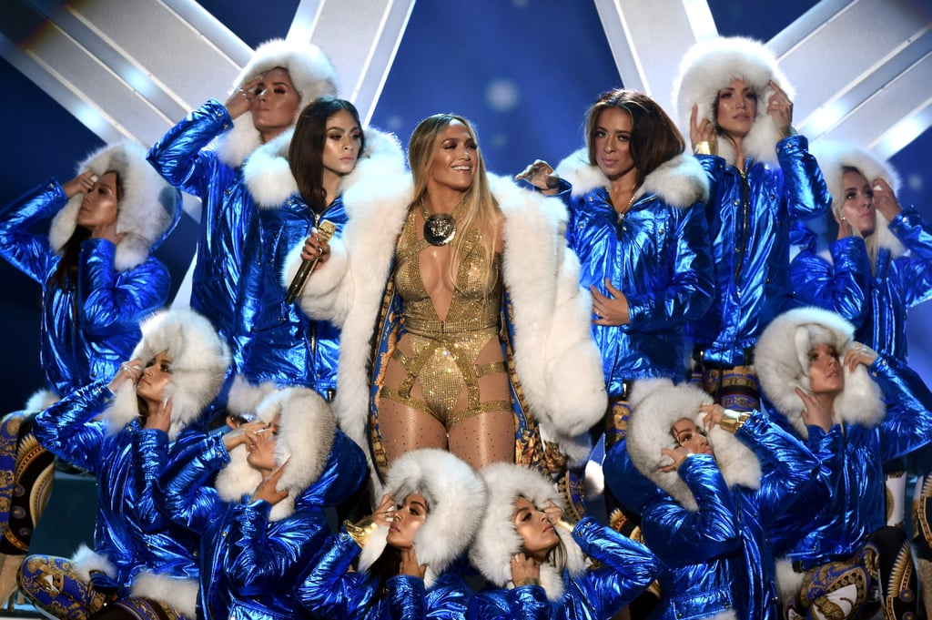 "Jennifer Lopez took home the gold (and silver) for her Video Vanguard Award performance! At the 2018 MTV VMAs, the 49-year-old queen performed at Radio City Music Hall and brought us (and her boyfriend, Alex Rodriguez) to our feet with her historic set. Jennifer sang a medley of her greatest hits like ""Get Right,"" ""Love Don't Cost a Thing,"" ""Jenny From the Block,"" and so, so many more. ""I grew up on MTV, and this is really a tremendous honor for me,"" she said during her acceptance speech. ""It has been an incredible journey of dreaming my wildest dreams and then watching them come true. Music, acting, and performing, this career has always been an obsession for me."" Our obsession was definitely watching Jennifer own the stage like a true icon. Not only did she have several outfit changes, but she even had an interlude and multiple dance segments. Savor every moment the cameras captured with the photos ahead.      Related:                                                                                                           As Usual, Jennifer Lopez Makes Sultry Look Effortless on the VMAs Carpet"