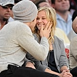 Jake Gyllenhaal and Reese Witherspoon laughed about sharing a kiss for the crowd on the big screen at the Lakers game.