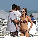 Molly and her husband, Scott Stuber, hit the beach with little Brooks.