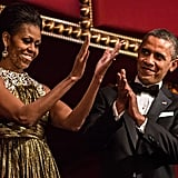 The first couple clapped during the Kennedy Center Honors.