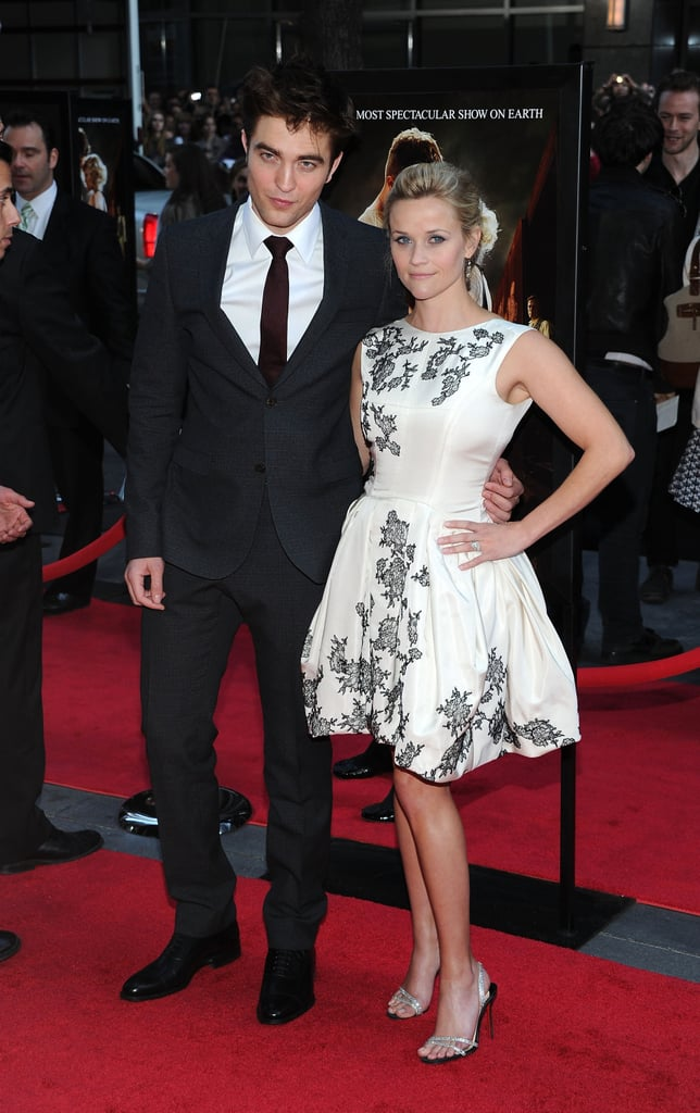 Robert Pattinson and Reese Witherspoon stepped out onto the red carpet for the world premiere of Water For Elephants in NYC tonight. The film's stars looked gorgeous as they signed autographs for fans and made their way down the press line. Reese wore a white Jason Wu dress while Rob looked especially handsome in a dark suit. We chatted with the duo about working together, with Rob saying that it was Reese who drew him to the project, and Reese sharing about her time in circus school. The costars are focusing on their latest big-screen project now that they've finished up other obligations. Rob just wrapped work on Breaking Dawn, and he celebrated with a party that included costars Kristen Stewart and Taylor Lautner, while Reese is coming off of her honeymoon in Belize with Jim Toth. In between their busy schedules, Rob and Reese got started promoting the movie with a shared cover of Entertainment Weekly. Rob was back in print for a feature in Elle and Reese also got her own spotlight in Vogue. Their work has just begun though, since Rob and Reese both have multiple press stops to make this week, including the morning show and late night rounds.