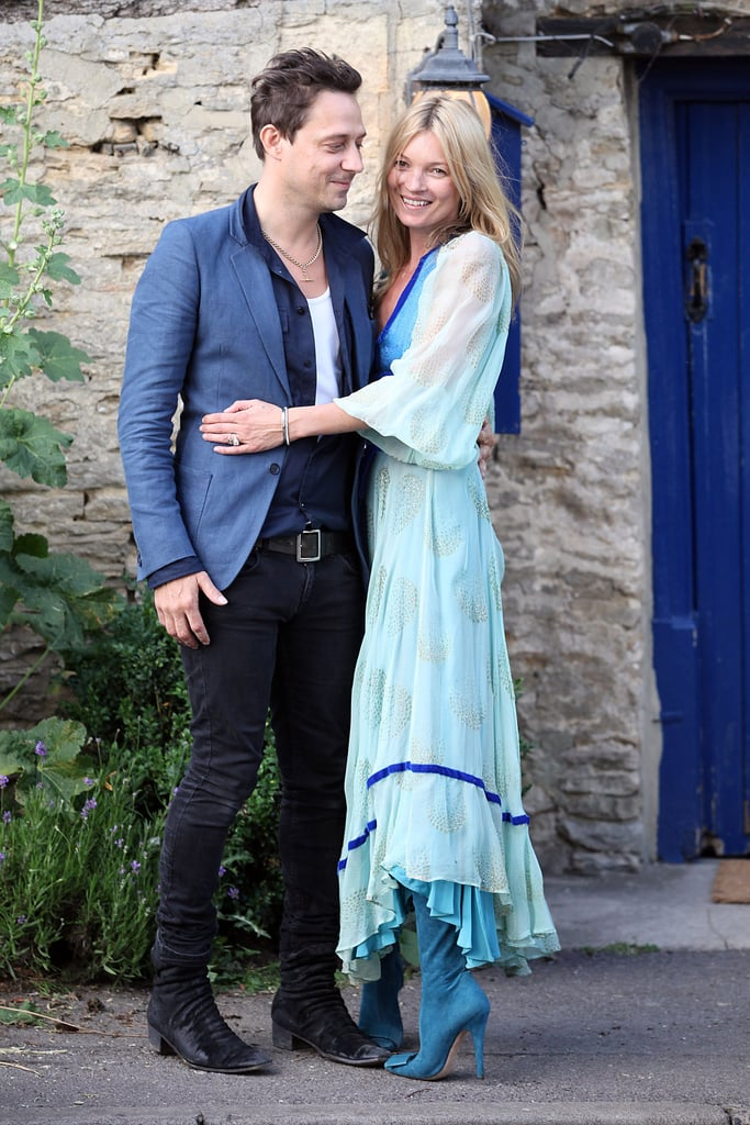 Soon-to-be-married Kate Moss and Jamie Hince looked so in love this evening outside St. Peter's Church in the small town of Southrop, England. The something blue was covered with Kate's vintage-looking dress, which she paired with  Tabitha Simmons boots. Kate, Jamie, their hairstylist pal James Brown, and his The Kills bandmate Alison Mosshart gathered in the English countryside today ahead of the big vow exchange tomorrow. Kate and Jamie have been planning their big day for months, but the pair have actually decided to stretch the party out in a three-day affair! Tents were erected at her place in the Cotswolds earlier this week, and decorations that range from nightclub to spa themes have been installed. British Vogue confirmed that Kate Moss's wedding dress was designed by her friend John Galliano, while her maid of honor, Trish Simonon, will wear Erdem and Sadie Frost will be in Christopher Beale. Kate Moss's wedding will be in September's US Vogue with photos from Mario Testino, so we'll get an inside scoop on what goes down at the three-day bash later this Summer!