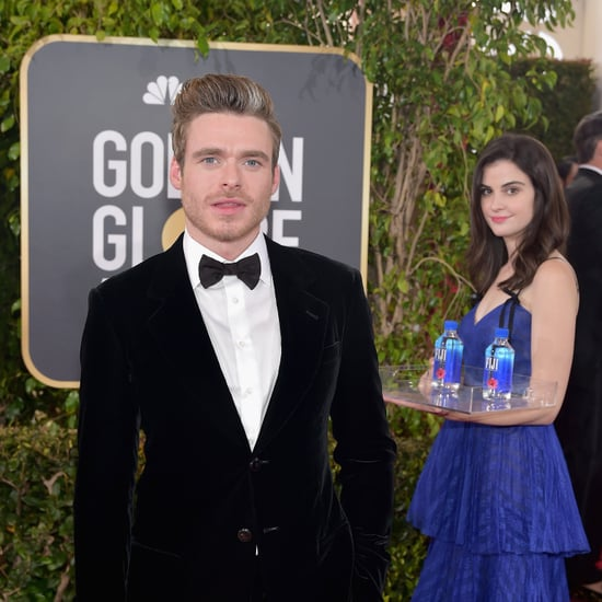 Girl Posing With Fiji Water on 2019 Golden Globes Red Carpet