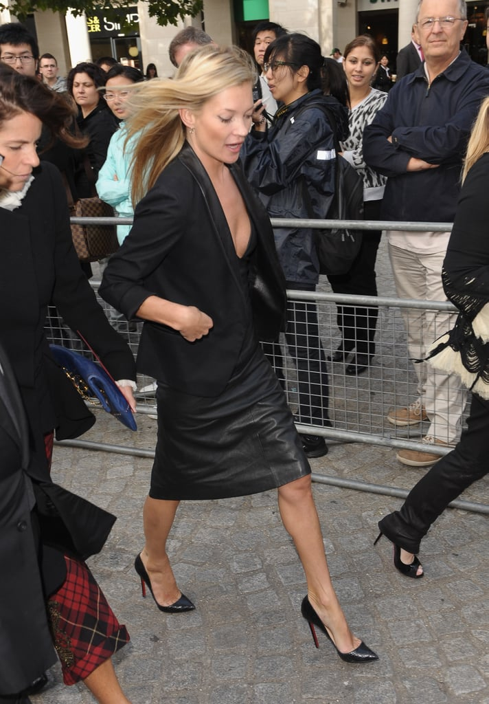 kate moss showed up in a black leather pencil skirt and