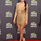 Selena Gomez wore a gold Julien Macdonald dress for the MTV Movie Awards.