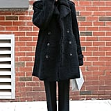 Kate Lanphear went all black and kept it classic with staple favorites like a double-breasted wool coat and pointed-toe pumps.