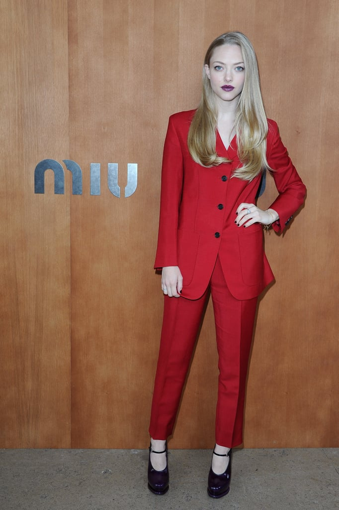 Amanda Seyfried wore a red pantsuit to the Miu Miu show during Paris Fashion Week.