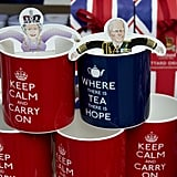 Mugs held paper cutouts of the royal couple.