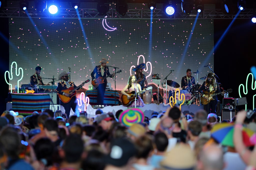 Kacey Musgraves playing with a sea of neon cacti in 2015.