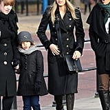 Jessica Alba bundled up in a black knit beanie and a military-style black Ferragamo coat while touring London.