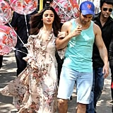 Walking the street with fellow actor Varun Dhawan in a long floral gown.