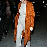 The sneaker proves versatile no matter what color Kendall's outfit is. Here she wore the Kam sneakers with a metallic outfit and orange duster coat.