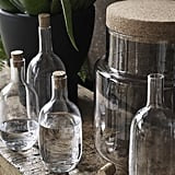 Hand-blown glass bottles ($10-$12) and lidded jars ($30) are one of the low-key and versatile decor offerings.