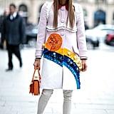 A bright coat and Chanel boots have Anna Dello Russo written all over them.