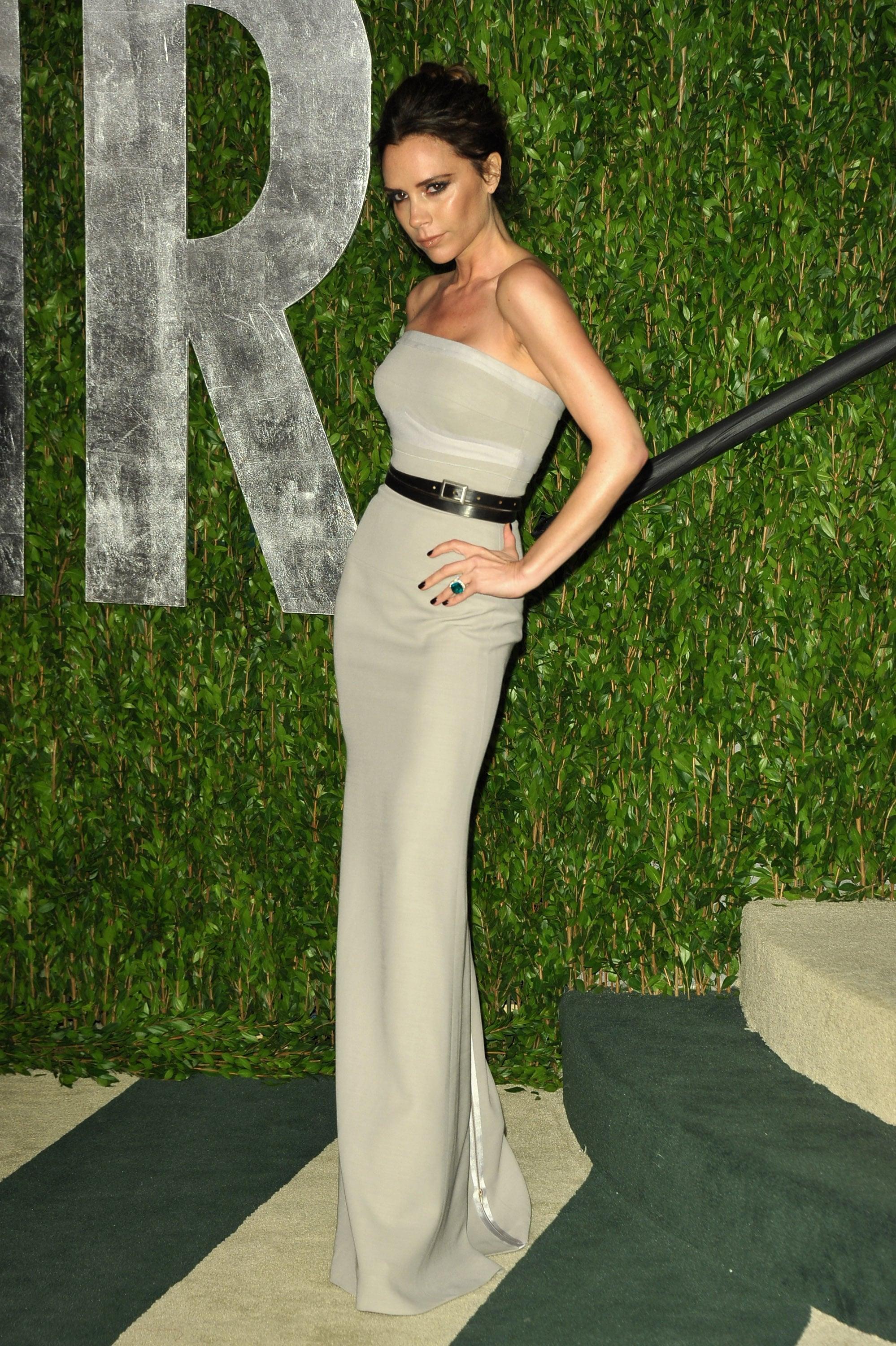 Victoria Beckham strikes a pose at the Vanity Fair Oscar party.