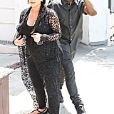 Kanye West held onto his forehead after running into a street sign.