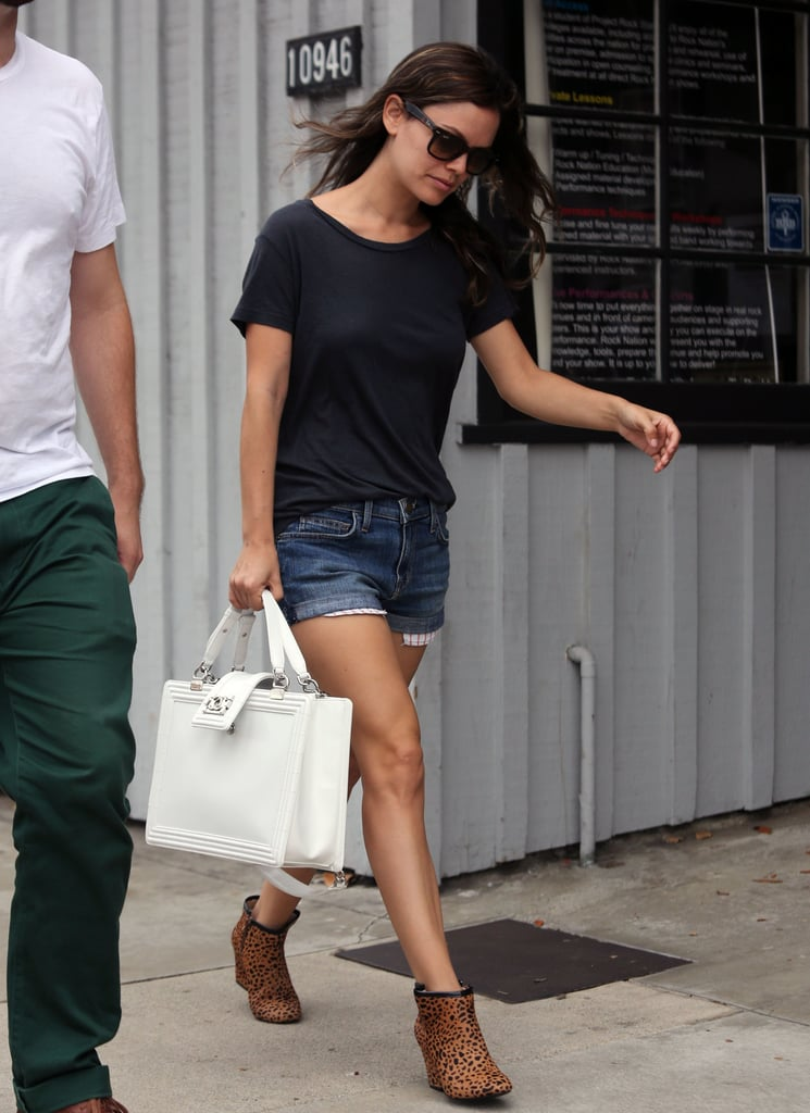 Rachel's black t-shirt, denim shorts, and leopard-print booties provide a great base for her standout bag. 8142946