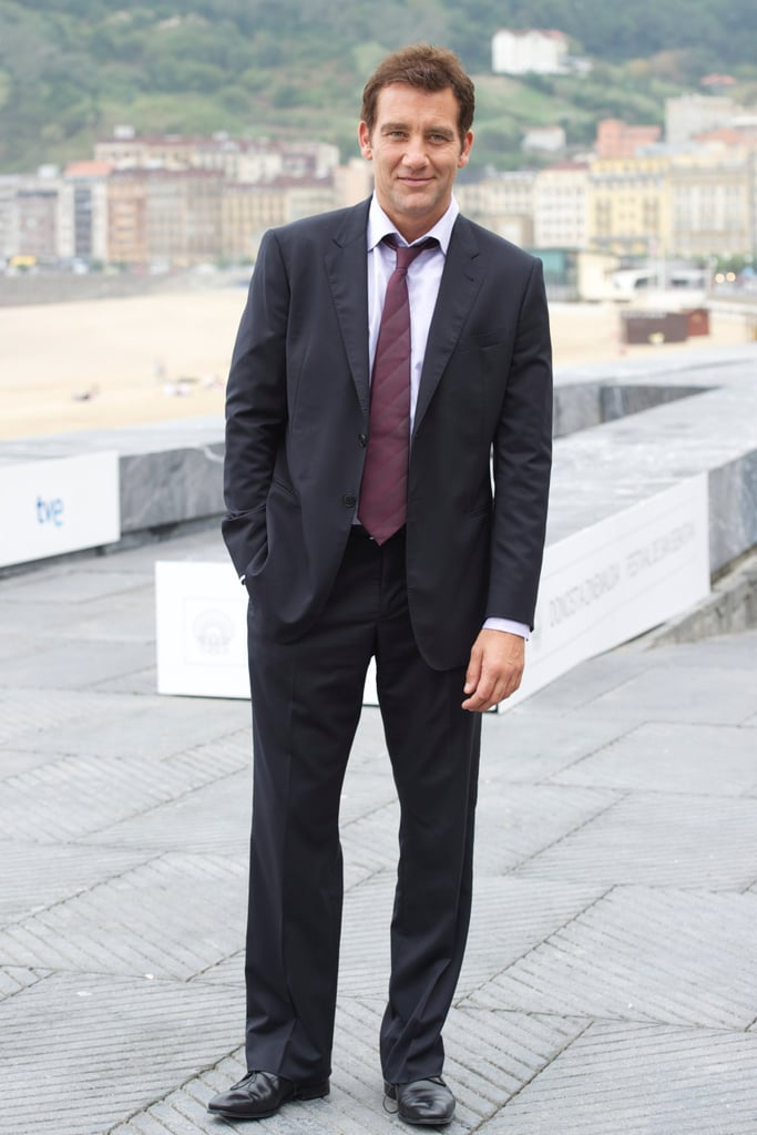 """Happy Friday! Here's hot Clive Owen striking a hot pose at a photocall at Spain's San Sebastian International Film Festival this morning. His Intruders is screening there, and Clive had director Juan Carlos Fresnadillo as well as costars Carice van Houten, Ella Purnell, Daniel Bruhl, and Pilar Lopez de Ayala for company. The group also attended a press conference for the project. Clive said of their thriller Intruders, """"I wouldn't really call it a horror film, it's much deeper, more psychological . . . All the fear and trepidation, the danger in the movie, it's within the characters, so it's a pleasure acting in a role like this. It was an ambitious thing to tie all the elements together and to bring them back on an emotional way. I was hugely excited by the possibilities and that's why I have done it."""" Clive's fresh off another round of photos and interviews over at Toronto, where he and Jason Statham did press for their movie The Killer Elite last weekend."""