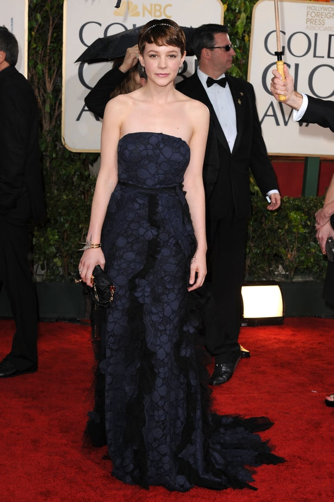 Carey Mulligan had a dark princess moment, complete with dazzling diamond headwear, in a navy-and-black tulle creation by Nina Ricci at the 2010 Golden Globes in Beverly Hills.