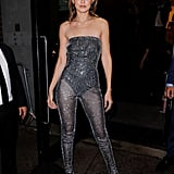 Gig wrapped up New York Fashion Week by wearing a sparkly jumpsuit over a black bodysuit, which she wore with black heeled sandals and Messika jewelry.