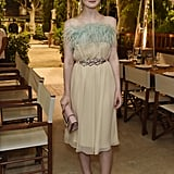 """Elle is the face of Miu Miu, which is my all time favorite brand. So when she attended a private Prada dinner at Cannes, she wore Miuccia's bedtime dress along with a Prada clutch, but finished the outfit with a pair of dainty Miu Miu drop earrings that were like the icing on the cake. Elle's champagne mules were the finishing touch to an outfit I really think I'd live in."" — SW"