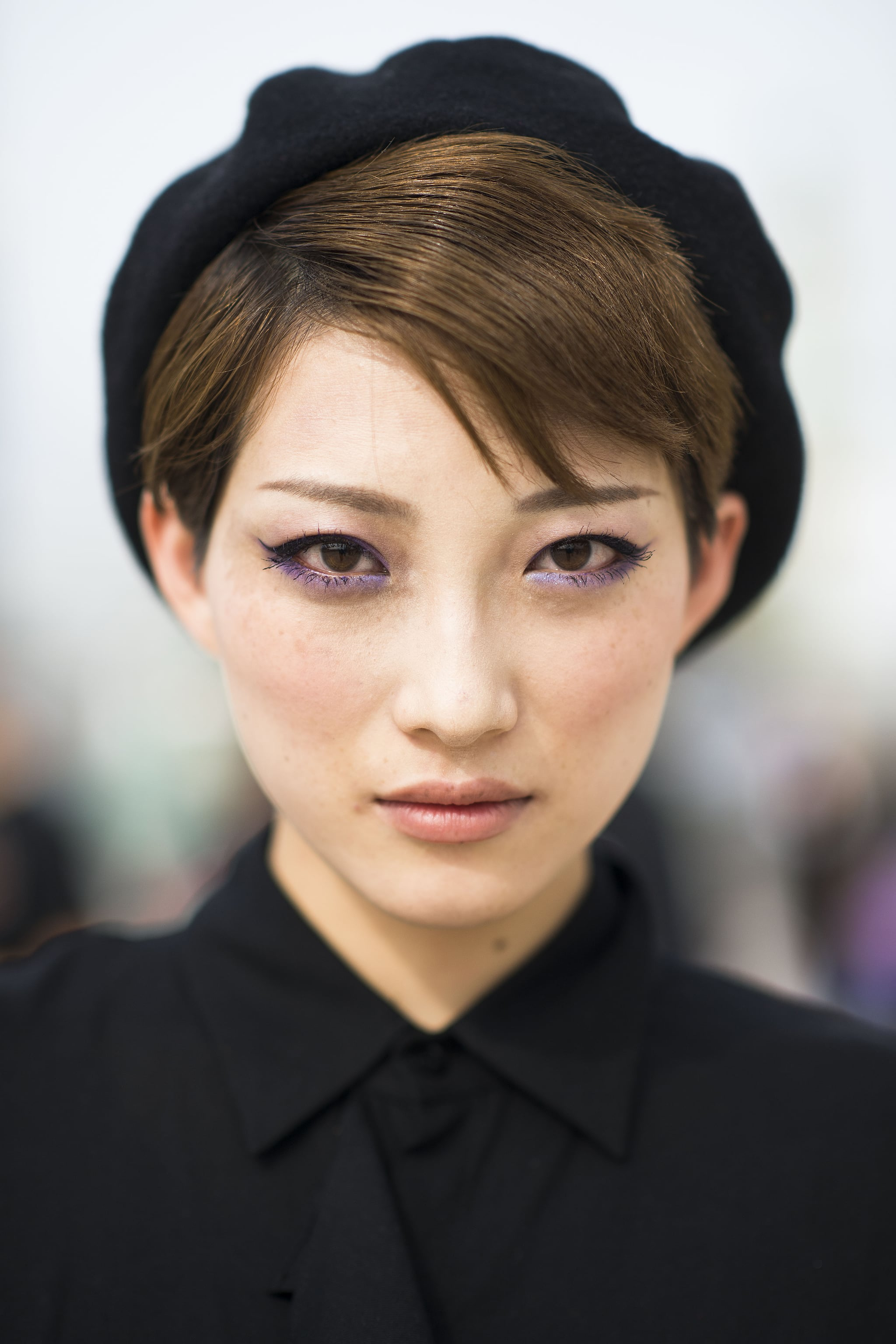 Winged eyeliner, purple shadow, and a black beret? We can't find one thing wrong with this look.   Source: Le 21ème | Adam Katz Sinding